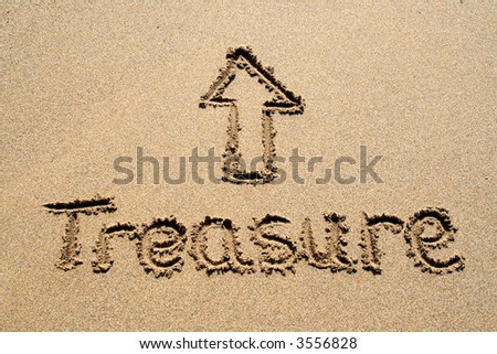 The word treasure written in the sand with a pointing arrow.