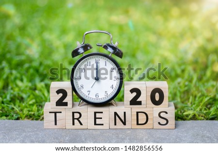 The word trends and 2020 new year on wooden cube blocks. 2020 trends concept. Main trend of changing something in new year.