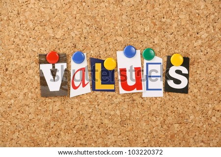 The word values in cut out magazine letters pinned to a cork notice board. May refer to social or business values.