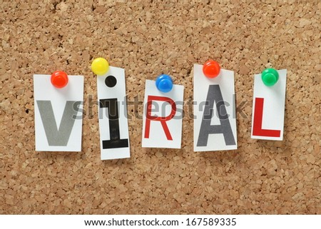 The word Viral in magazine letters pinned to a cork notice board Viral is often used to describe an image video or product that is widely circulated on the internet
