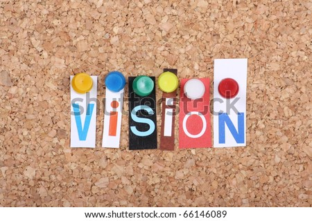 The word Vision in cut out magazine letters pinned to a cork notice board as a concept for success in business