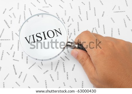 The word, VISION is magnified.