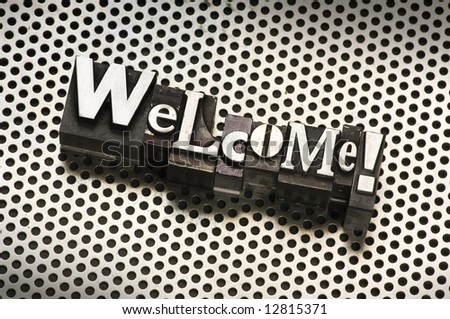 """The word """"Welcome!"""" done in old letterpress type."""