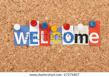 The word Welcome in cut out magazine letters pinned to a cork notice board