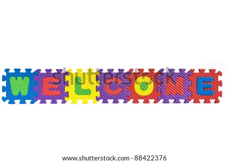 "The word ""Welcome"" written with alphabet puzzle letters isolated on white background - stock photo"