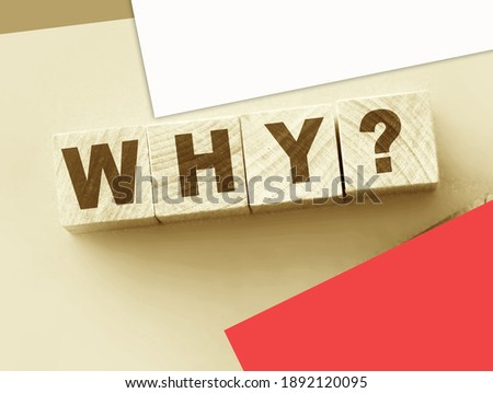 The word Why wrote of Building Blocks and pink wallet. Reasons of having or not having money, of being rich or poor concept. Photo stock ©
