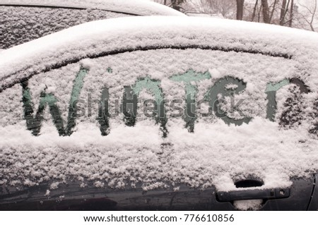 """The word """"winter"""" etched into snow on car window #776610856"""