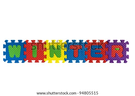 "The word ""Winter"" written with alphabet puzzle letters isolated on white background"