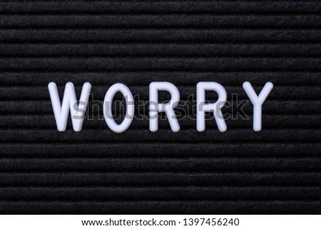 The word WORRY, on a letter board.