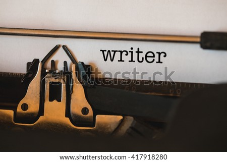 The word writer against close-up of typewriter