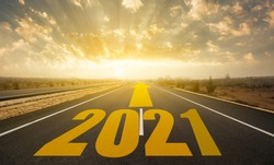 The word 2021 written on highway road. Concept for new year 2021