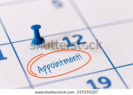 The words Appointment written on a calendar to remind you an important appointment