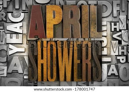 The words APRIL SHOWERS written in vintage letterpress type