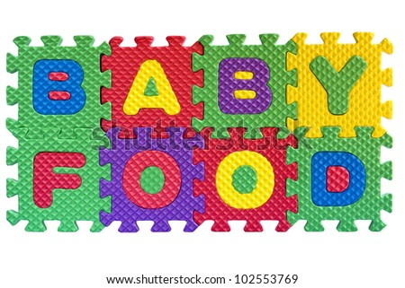 """The words """"Baby food"""" written with alphabet puzzle letters isolated on white background"""