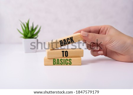The words back to basics made of letters on wooden blocks. back to basics - fundamental principles concept Сток-фото ©