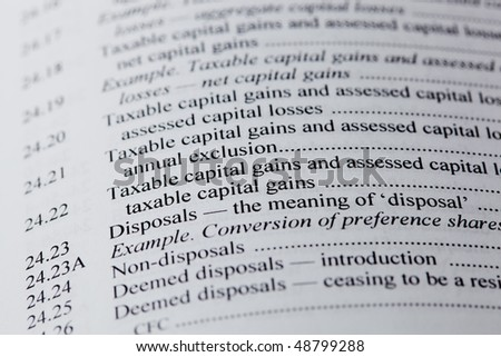 The words capital gaans and tax on white paper