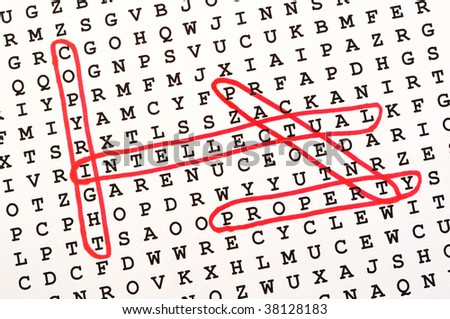 The Words Copyright, Intellectual, Property, & Patent on Word Search Puzzle Circled in Red Ink