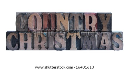 the words 'country Christmas' in old, ink-stained wood type