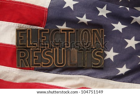 the words election results in old wood type on an American flag