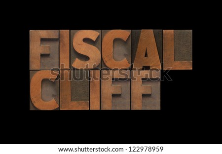 the words 'fiscal cliff' isolated on black