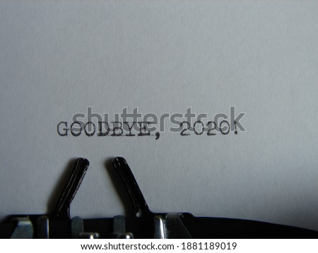 """the words """"GOODBYE 2020!"""" typed on a typewriter, close up"""