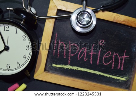 The words Inpatient handwriting on chalkboard on top view. Alarm clock, stethoscope on black background. With education, medical and health concepts