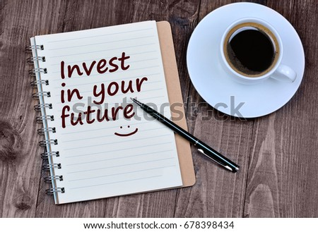 The words Invest in your future on notebook page #678398434