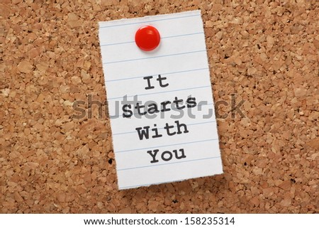The Words It Starts With You Typed On A Scrap Of Lined Paper And Pinned To A Cork Notice Board. A Concept For Customer Service Or Self Improvement, Adapting To Change Or Making Plans.