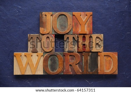 the words joy to the world in old wood type