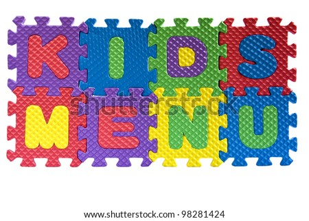 "The words ""Kids menu"" written with alphabet puzzle letters isolated on white background"