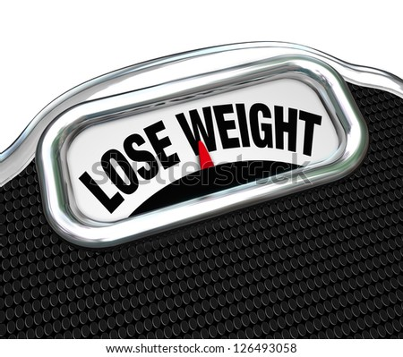 The words Lose Weight on the display of a scale to tell you you need to go on a diet to drop pounds and trim fat to improve your health