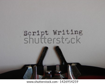"the words ""script writing"" typed on a typewriter"