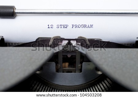The words 12 Step Program typed on an old typewriter.