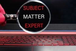 the words subject matter expert through a magnifying glass on the laptop.