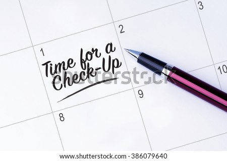 The words Time for a Check-Up written on a calendar planner to remind you an important appointment with a pen on isolated white background.  Stock photo ©