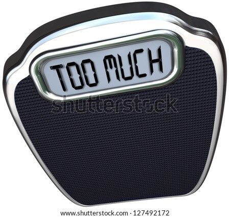 The words Too Much on the digital display of a scale symbolizing surplus, overabundance, overweight, fat and in need of a diet Foto stock ©