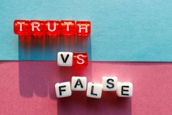 the words truth and lie are made up of cubes on different colored backgrounds. confrontation between truth and lies