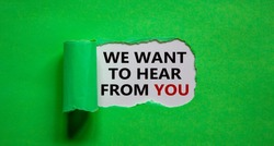 The words 'we want to hear from you' appearing behind torn green paper. Beautiful background. Business concept.