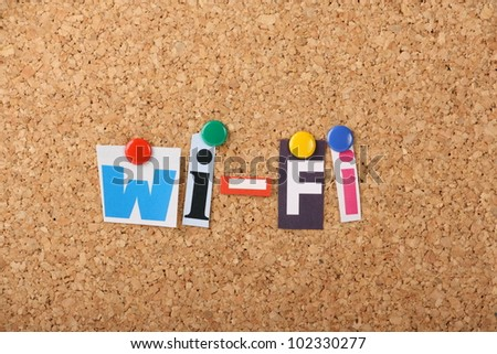 The words WI-Fi in cut out magazine letters pinned to a cork notice board