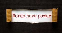 The words 'words have power' appearing behind torn black paper. Beautiful background. Business concept.