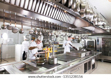 the work of the cook in the kitchen of the restaurant Stock photo ©