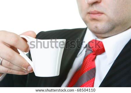 The worker of office on a workplace drinks tea or coffee