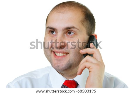 The worker of office on a workplace talks by a mobile phone