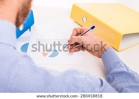 The worker prepares a corporate documents - studio shoot