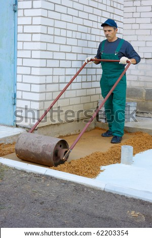 The worker prepares a place for a paving - stock photo