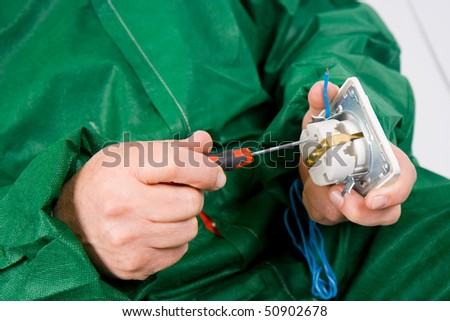 the worker repairing the socket