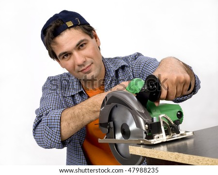 The worker. The Man-worker with the electrotool. Photographing in studio on a white background.