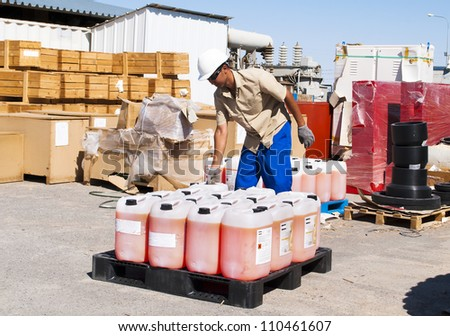 the worker works at a warehouse. Moving of canisters.