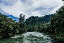 The world famous clear water rapid of Asahan River surrounded by dense rainforest is perfect for kayak and white water rafting, North Sumatra, Indonesia.