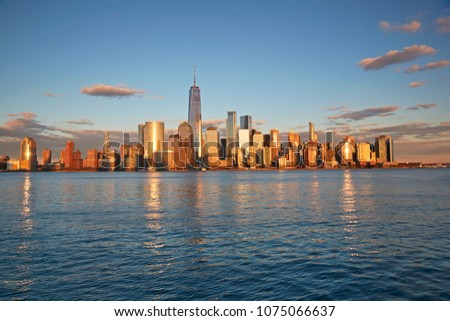 The world famous downtown skyline of downtown Manhattan, New York City at sunset